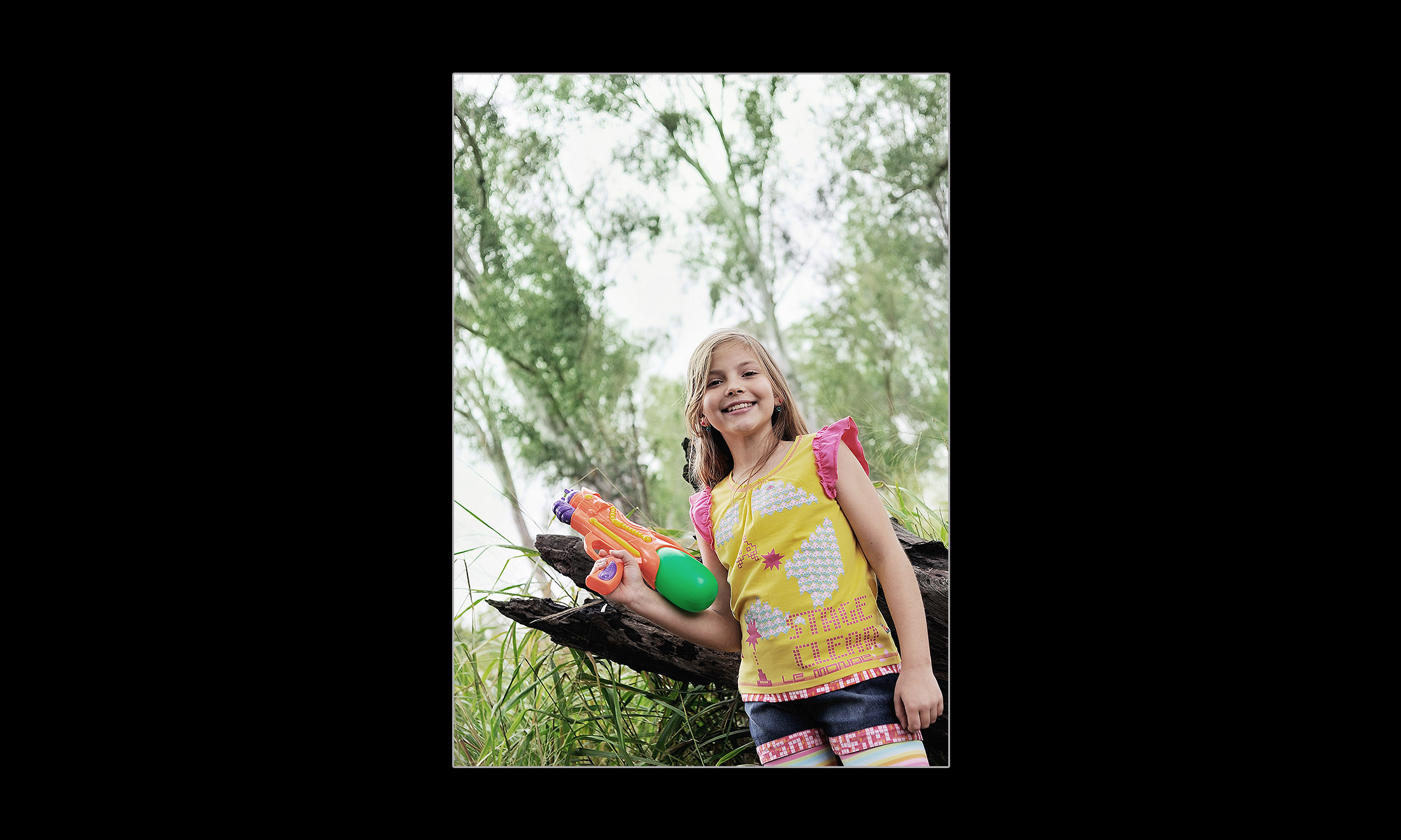 a girl holding a water gun 08