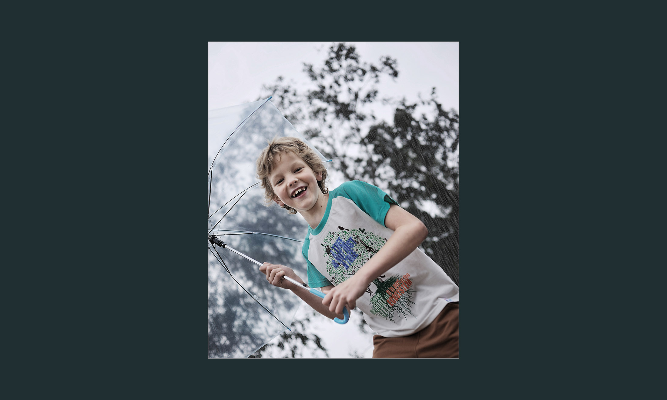 a kid holding umbrella 10
